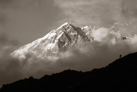 Climber with Lobuje as backdrop, Nepal